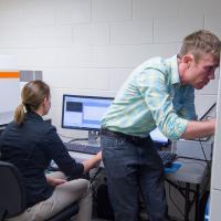 Combining Raman imaging with nanoindentation